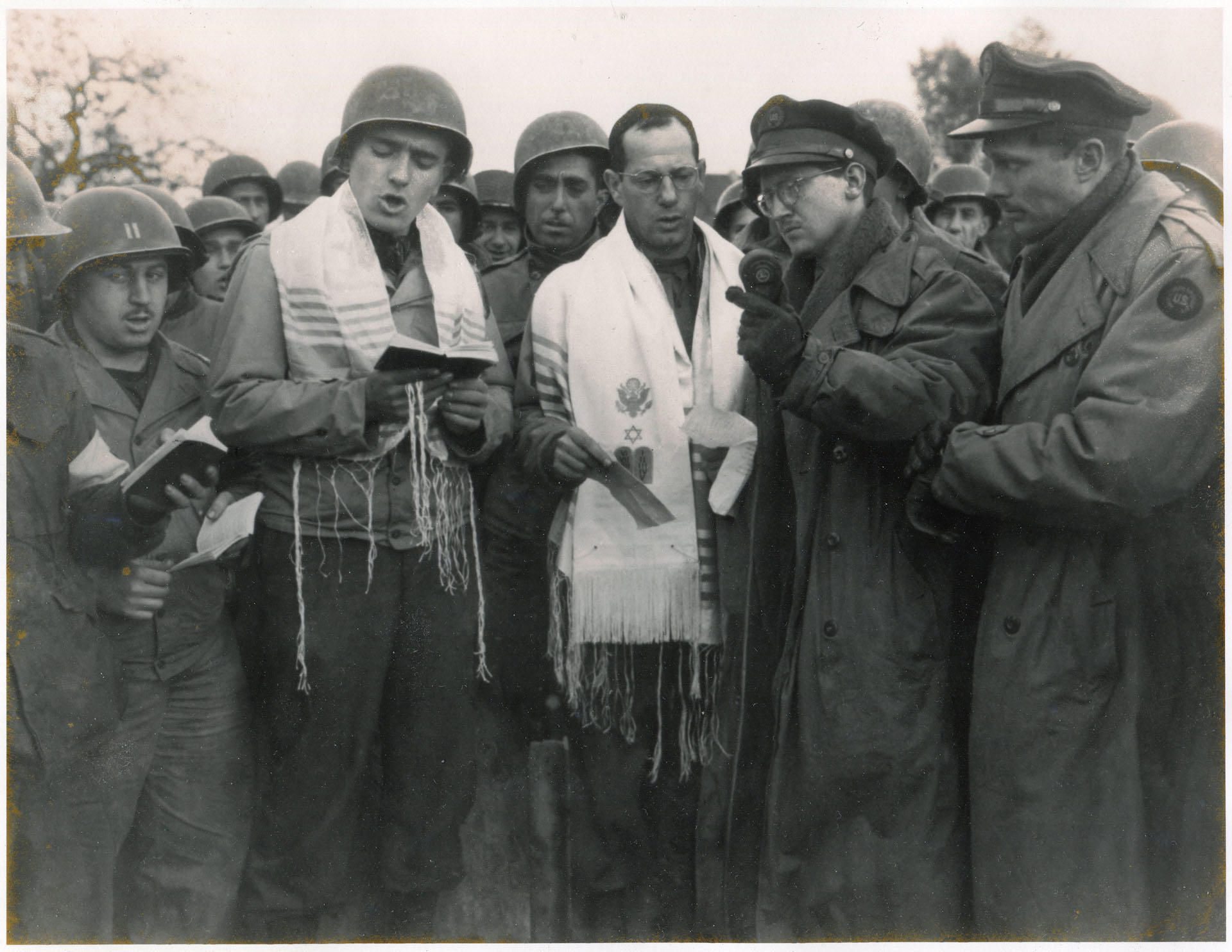 Max Fuchs and Rabbi Chaplain Sidney Lefkowitz. He is singing in Aachen, Germany during the first Jewish service to be held on German soil since the rise of Hitler