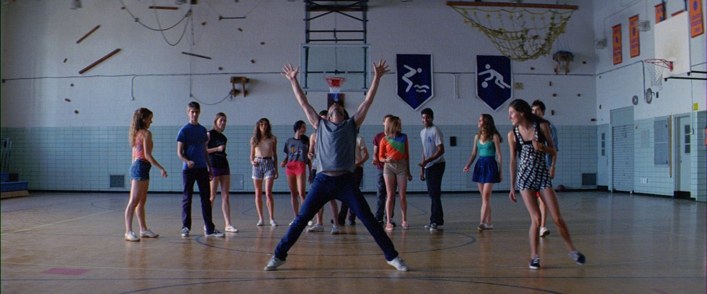"Adam, Tiler, and cast dance in a gym in ""Improvisations"""