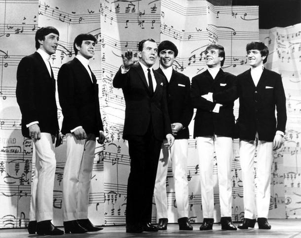 The Dave Clark Five with Ed Sullivan, of The Ed Sullivan Show.