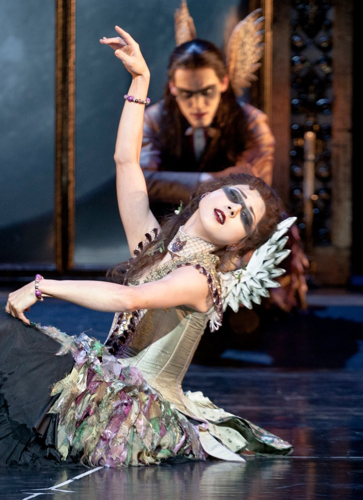 A fairy performs for baby Aurora in Matthew Bourne's Sleeping Beauty.