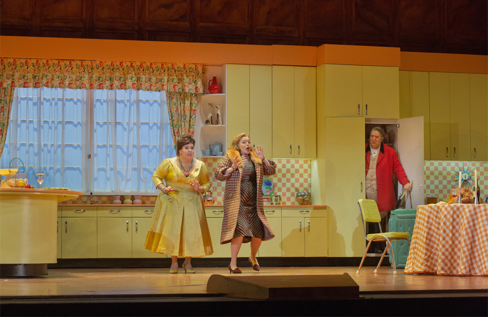 "Angela Meade as Alice, Jennifer Johnson Cano as Meg Page, and Ambrogio Maestri in the title role of Verdi's ""Falstaff."""