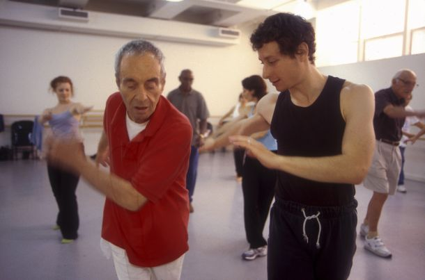 Martin Thall, member of Brooklyn Parkinson Group, dances with David Leventhal at the Mark Morris Dance Center. Photo: Katsuyoshi Tanaka.