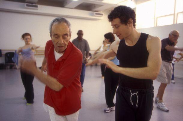 Martin Thall, member of Brooklyn Parkinson Group, dances with David Leventhal at the Mark Morris Dance Center. Photo: Katsuyoshi Tanaka.