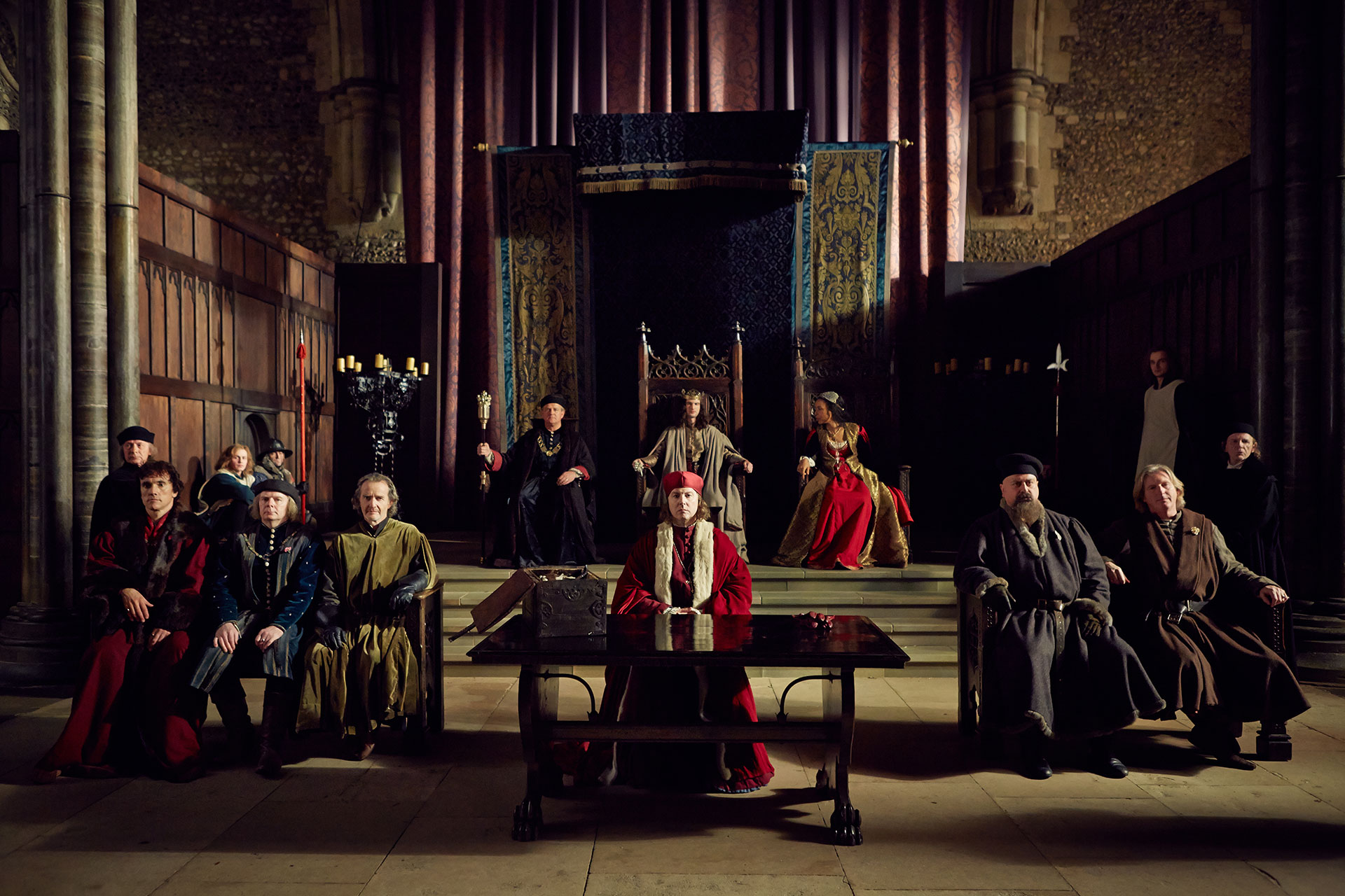 "(From l to r) Ben Miles (as SOMERSET), Jason Watkins (as SUFFOLK), Anton Lesser (as EXETER), Hugh Bonneville (as GLOUCESTER), Tom Sturridge (as HENRY VI), Samuel West (as BISHOP OF WINCHESTER), Sophie Okonedo (as MARGARET), Stanley Townsend (as WARWICK) and Adrian Dunbar (as PLANTAGENET) in ""The Hollow Crown: The Wars of the Roses Henry VI (Part I)."" Credit: Robert Viglasky © 2015 Carnival Film & Television Ltd"