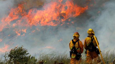 Wildfires in western states are disrupting efforts to curb air pollution