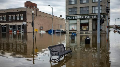 How do riverfront businesses handle extreme flooding in Iowa?
