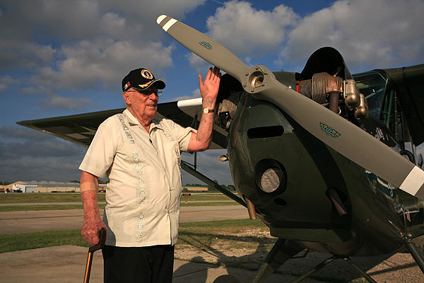 US WWII veteran, Dan Illerich, the sole surviving downed airmen rescued by the Dayak tribesmen pictured with a L-3 Aeronca, a lightaircrft similar to the plane in which he was rescued from Borneo.