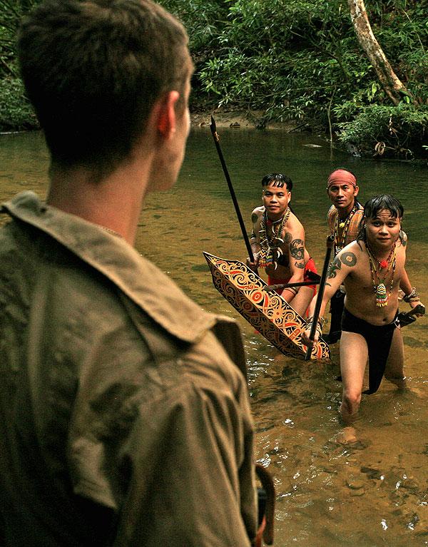 An reenactment scene of downed American Airmen meeting Dayak tribesmen shot in Nanga Ulai, Sarawak, Borneo.