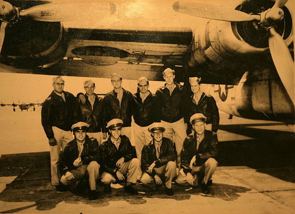 """Dan Illerich pictured with his B-24 Liberator bomber crew – """"The Coberly Crew,"""" who were shot down over Borneo in 1944. The downed airmen were rescued and protected from the Japanese by headhunting members of the Dayak tribe."""