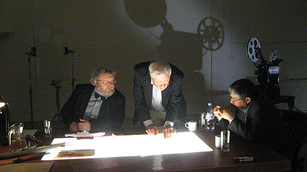 """Historians in the film's """"War Room"""" explore the secrets of Japan's secret I-400 aircraft-carrying submarine. From left to right: Eric Grove, Carl Boyd, Osamu Tagaya."""