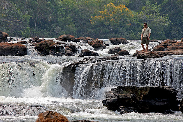 Niall McCann, Explorer/Biologist, is at Kamukuakua Falls- in the Mato Grosso, Brazil; sacred to the Bakairi Indians, the waterfall is one of the signposts for Fawcett's Lost City of Z.