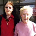 "(From left) Maura Stephens, 60, and Angela Flynn, 73, stand outside the Waterford Visitor Center on the final day of the sit-in. Stephens worked in the blowing room for 32 years. She echoes a sentiment common among Waterford Crystal workers: disappointment that the government did not step in to help keep manufacturing in Waterford. ""To think of all that craft walking around the town,"" she says, ""people with that gift and not being able to use it. It's still not...sinking in."" Flynn worked in the canteen at Waterford Crystal for 18 years. Her son, Ted Flynn, worked in the blowing room and left on a voluntary severance package in December 2008. As part of his package, he was due to receive $850 per week for 12 months, but he received no payments after the company went bankrupt a month later."
