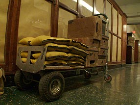 A cart of sandbags and apple crates – that is, weights and stepstools. Credit: Maggie Villiger