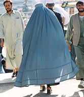 Photo of a woman wearing a burka and walking through a crowd