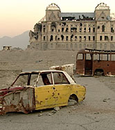 Photo of palace ruins and abandoned vehicles -- now a common sight in Afghanistan