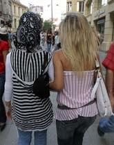 Photo of modern Turkish women experiencing first hand the convergence of east and west.