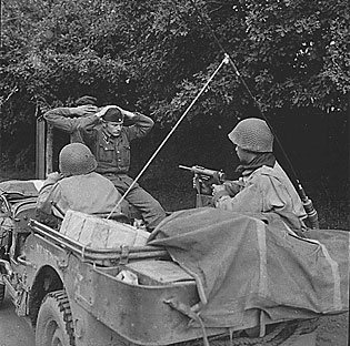 Prisoners of war in a jeep