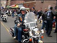 Father Giordani on his bike
