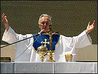 Father Giordani says Mass